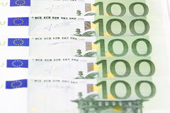 Close-up of One hundred euro banknotes. On white background Stock Photos