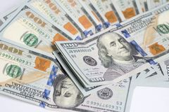 Close up of one hundred US dollar money bills spread on white ba Royalty Free Stock Photo