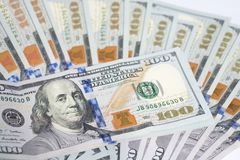 Close up of one hundred US dollar money bills spread on white ba Stock Photography