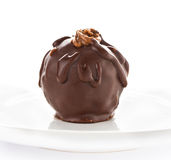 Close up of one large dark chocolate ball on white background Stock Image