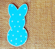 Close-up of one paper rabbit silhouette frame against canvas background.  Royalty Free Stock Images