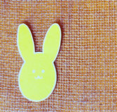 Close-up of one paper rabbit silhouette frame against canvas background.  Stock Photography
