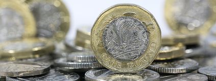 Close up of One Pound Coins - British Currency Royalty Free Stock Photos
