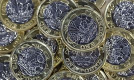 Close up of One Pound Coins - British Currency. Close up of one pound coins in a pile - directly overhead in a horizontal format Stock Images
