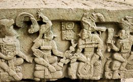 Alter Q, Copán, Honduras. Close up of one side of the Alter Q sculpture. This alter shows on its four sides all 16 of the Classic Mayan rulers of Copán stock photo