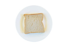 Close-up one slice of white bread on the plate, isolated on whit Royalty Free Stock Photography