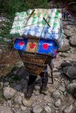 Close up of one traditional sherpas carrying heavy bag stock image