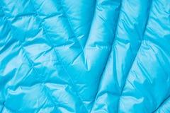 Close-up op de blauwe textuur van het kogelvisjasje Achtergrond van gewatteerd materiaal stock foto