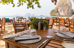 Close up of open-air restaurant on beach Stock Photo