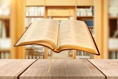 Composite image of close up of open book. Close up of open book against library stock photos