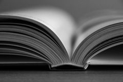 Close up on an open book in black and white stock photos