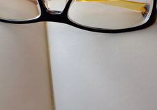 Close-up open empty notebook with glasses Royalty Free Stock Images