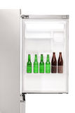 Close up of an open fridge full of beer bottles Stock Photo