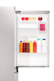 Close up of an open fridge full of healthy food products royalty free stock image