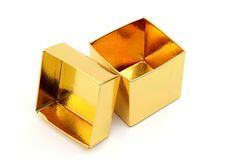 Open Gift Box. Close-up of an open, gold foil gift box Royalty Free Stock Image