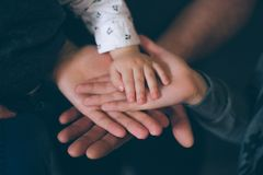 Close Up Open Hands Of Man And Woman And Kid With Palm Up . Family Together Helping  Harmony  And Caring Concept Royalty Free Stock Photo