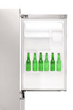 Close up of an open refrigerator full of beer bottles Stock Photos