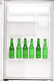Close up of an open refrigerator full of beers Royalty Free Stock Photos