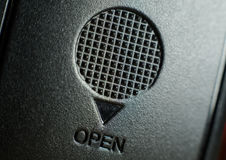 Close up on the open sign annd the cross texture on the cover of Royalty Free Stock Images