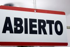 Close-up of an open sign in spanish. `Abierto` stock photography