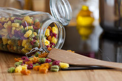 Close up of an open Storage Jar with colorful Pasta Stock Photos