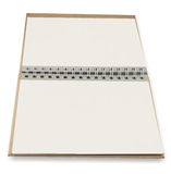 Close up of open textbook with pages. Close up of open textbook with blank pages Stock Photo