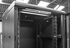 Close-up of an opened Computer Server Cabinet seen within an industrial location. This floor standing Data Centre and Server cabinet is used to house networking royalty free stock photos