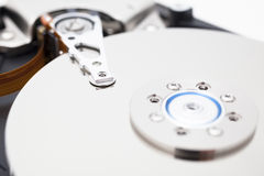 Close up of opened hard disk drive, data saving. A hard disk drive open, photographed in studio close up Stock Images