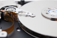 Close up of opened hard disk drive, data saving. A hard disk drive open, photographed in studio closeup Stock Image