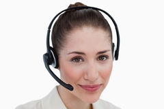 Close up of an operator posing with a headset Royalty Free Stock Photos