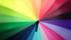 Close-up of optical effect from spinning rainbow multicolored umbrella