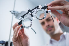 Close-up of optometrist holding messbrille. In ophthalmology clinic Stock Image
