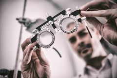 Close-up of optometrist holding messbrille. In ophthalmology clinic royalty free stock photography