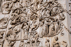 Close-up of the opulent and elaborated embossed sculptures in the Orvieto Cathedral at Orvieto. Royalty Free Stock Photo