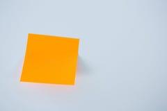Close-up of orange adhesive note Royalty Free Stock Photo