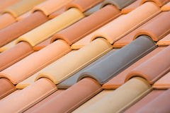 Close up of orange clay roof tiles. With selective focus Stock Photo