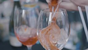A close up of orange cocktails, glasses and ice. Frame. Perfect summer drinks stock video footage