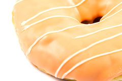 Close up orange donut. On white background Royalty Free Stock Photography