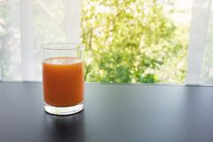 Close up orange juice glass in morning with window view.Healthy drink. Concepts images stock photography