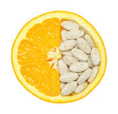 Close up of orange and pills isolated. Vitamin concept Royalty Free Stock Photography