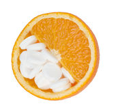 Close up of orange and pills isolated - vitamin concept Royalty Free Stock Images
