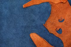 Close up orange rough edge and navy blue leather divide in two s. Ection, fashion texture background,fabric division Royalty Free Stock Photo