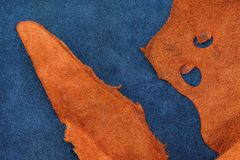 Close up orange rough edge and navy blue leather divide in two s Royalty Free Stock Photo