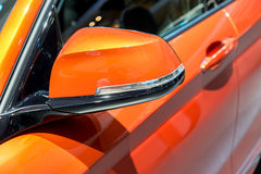 Close up of Orange Side Mirror Car.  Stock Photo
