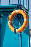 Orange Lifebuoy with Ropes on Lifeguard Chair royalty free stock photo