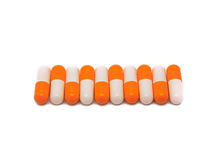 Close-up of orange-white pills row Royalty Free Stock Images