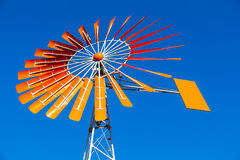 Orange Windmill Against a Blue Sky Royalty Free Stock Photos
