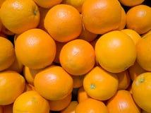 Close-up oranges. Close-up pile of oranges in supermarket stock images