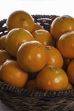 Close up of oranges in traditional woven basket Royalty Free Stock Photo