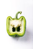 Close up of an organic green bell pepper, showing inside Stock Photo